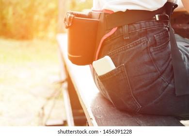 Sports running bag on the belt of a girl in sunrise.