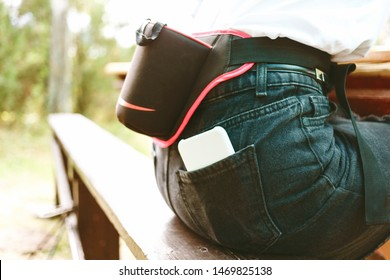 Sports running bag on the belt of a girl