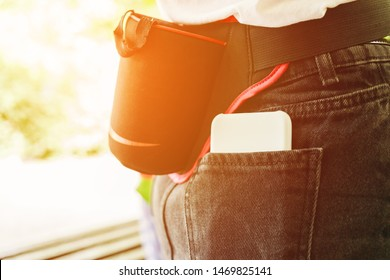 Sports running bag on the belt of a girl in sunrise