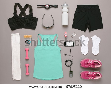 Sports set. / Running equipment woman on grey background.