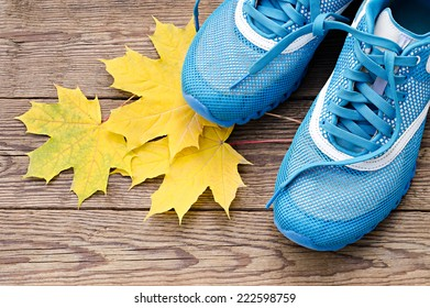 sports shoes and autumn leaves