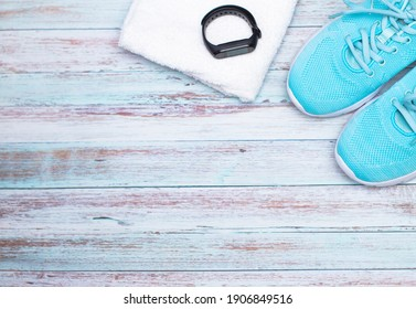 sports shoes, fitness bracelet on a white background. top view.