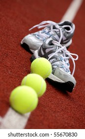 Sports shoes for tennis on court background