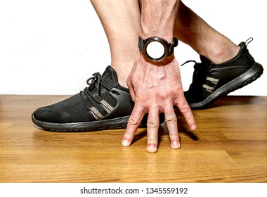 Sports smart watch on the athlete's hand at the start on a white background