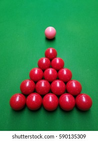 Sports Snooker Pink balls and the red ball on the green cloth, ready to start a new game
