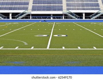 Sports stadium with football field and track