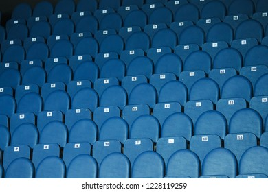 sports stadium, large concert hall, lot of empty chairs on spectator stands in rows with numbers corresponding to tickets, room before big event, seats are sold out, the background texture, football