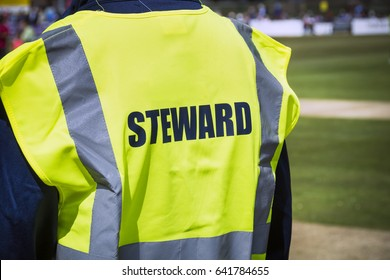 Sports steward by pitch in high viz jacket