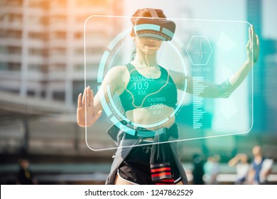 sports technology concept.Beauty asian woman running by virtual reality in the city. VR headset glasses device.running woman and various technological.