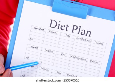 Sports trainer with diet plan close-up