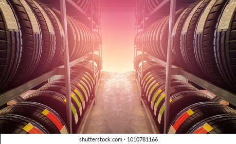 Sports and Transportation Tire rubber products , Group of new tires for sale at a tire store.