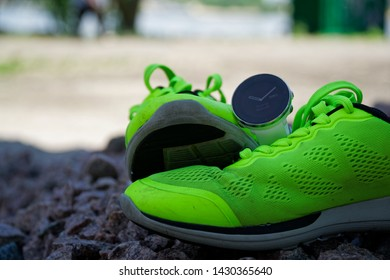 Sports watch for run on on the green running shoes. Smart watch for tracking daily activity and strength training