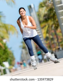 Sports woman skating outdoors keeping a healthy lifestyle