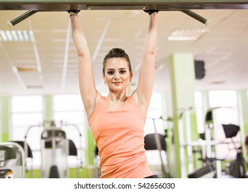 Sports young beautiful woman pulled out in the gym. The concept of fitness, sport and lifestyle.