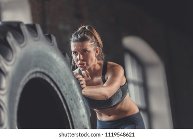Sports young girl with a wheel close-up