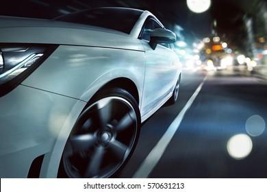 Sportscar drives through a night city