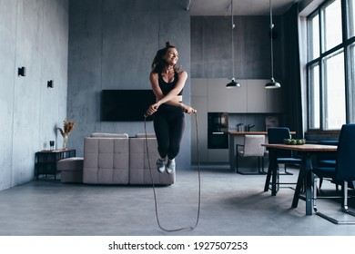 Sportsgirl with skipping rope at home. - Shutterstock ID 1927507253