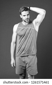 Sportsman after training feel pleasant aroma. Guy check armpit dry skin. Prevent or reduce perspiration. Choose proper antiperspirant or deodorant for training. Man satisfied his antiperspirant.