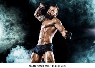 Sportsman boxer fighting on black background. Copy Space. Boxing sport concept.