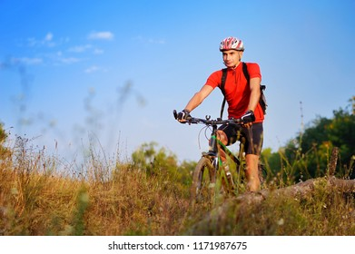 Sportsman cycling at the wild nature in the early autumn