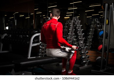 the sportsman is engaged in an exercise room, pumps muscles, a biceps and a press
