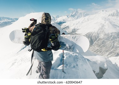 sportsman go with snowboard equipment on the snow hill and mountain range