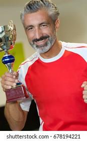 sportsman holding a trophy