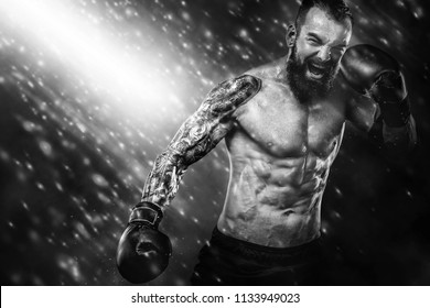 Sportsman muay thai boxer fighting on black background with smoke. Copy Space. Sport concept.