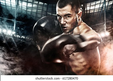 Sportsman muay thai boxer fighting in boxing cage. Background with lights and smoke. Copy Space. Sport concept.