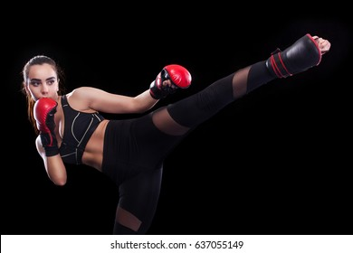 Sportsman muay thai boxer fighting. Isolated on black background. Copy Space.