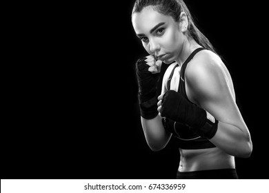 Sportsman muay thai boxer fighting. Isolated on black background. Copy Space. Sport concept.