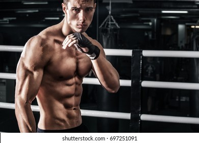 Sportsman muay thai boxer fighting in boxing cage. With copy Space. Sport concept.