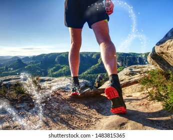 Sportsman on trail. Slim body man in yellow jersey, black shorts and running shoes run in wild nature. Abstract filter.
