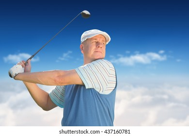 Sportsman is playing golf against bright blue sky over clouds