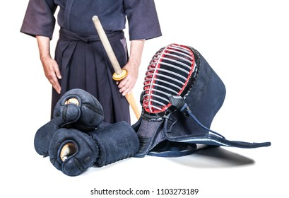 sportsman and protective equipment 'bogu' and bamboo sword 'sinai'  for Japanese fencing Kendo training close-up