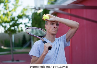sportsman with racket holds ball sport tennis