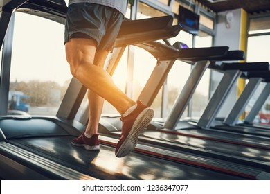 Sportsman running on a treadmill at the gym