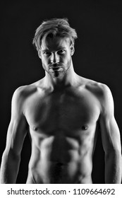 Sportsman show six pack and ab muscles. Bodybuilder with sexy chest and belly. Man athlete with fit torso. Workout and training activity in gym. Sport bodycare and fitness concept, black and white.