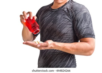 Sportsman taking a vitamin and medicine before and after his training