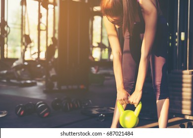 sportsman training for strength and balance muscle at powerful gym