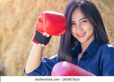 Sportsman, Woman with fighting stance against. Sexy fighter girl punching actively. Woman boxer fighting in gloves. Strong hand and fist, ready for fight and active exercise. Boxing and fitness concep