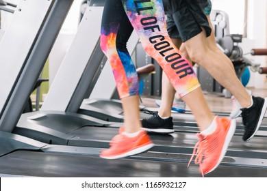 Sportsmen running on treadmill