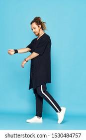 Sportswear break dance man dreadlocks party disco sneakers isolated blue background