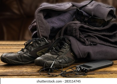 sportswear,  smartphone and accessories  on wooden background