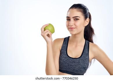 sportswoman with apple, fitness