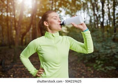 Sportswoman drinking isotonic drink