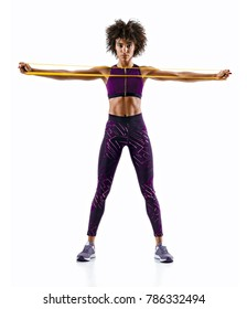 Sportswoman performs exercises for the muscles of the chest. Photo of young woman workout with resistance band isolated on white background. Strength and motivation.