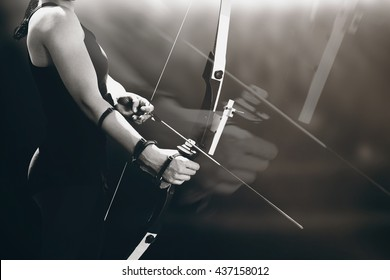 Sportswoman practicing archery