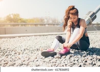 Sportswoman tying sneakers
