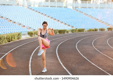 Sporty Asian woman training at the stadium